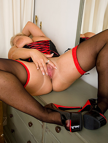 Busty milf robyn in red and black lingerie spreading in this one