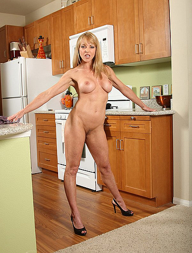 Horny Blond Housewife Being Naughty In The Kitchen