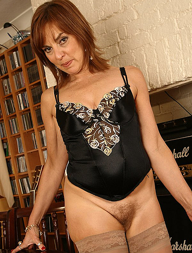 Redheaded Mature Lady Teases Out Of Her Evening Dress