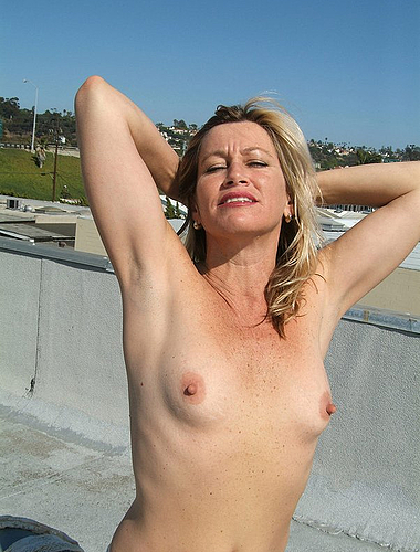 Horny Blond Housewife Gets Nude On The Rooftop