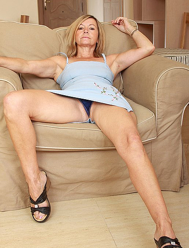 Naughty Blond Mature Shows Off Her Body On The Couch