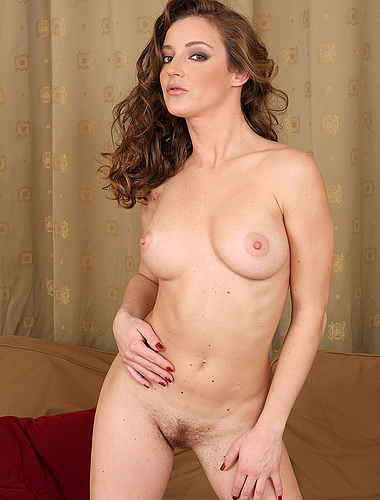 Elegant Judith from AllOver30 shows off her perfect tits and furry pussy