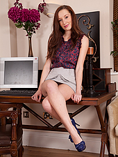 Daisy is one natural woman anyone would want in their workplace. Her sexy long legs lead all the way up to her sexy ass and fluffy pussy. Take a closer look as she spreads for you