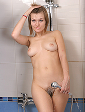 Marizza casually brushes her pussy hair before using the handle as a dildo. She only gets hornier and fills herself with warm water then squirts it out her tight pink lips.