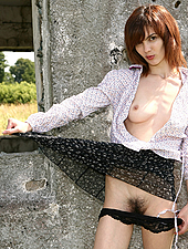 Slender Karin takes a quiet walk in the sun. Things start to heat up when she gets horny and parades her lovely hairy pussy and fit body around naked at a old derelict building.