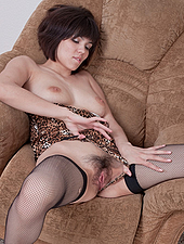 Sasha M spreads her legs on the chair