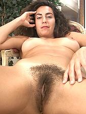 Sexy Liz brushes her thick bush
