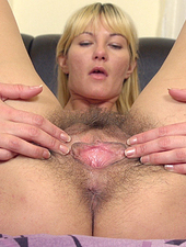 Hairy blonde Vanessa J has big natural tits