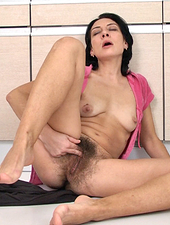 Eva slowly strips then shows the hairy goods