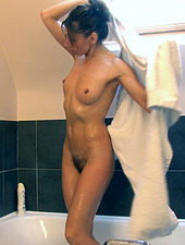 Hairy woman Chloe R fingers her pussy in the tub