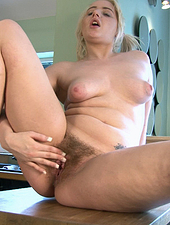 Jenny Davies fingers her hairy pussy in kitchen