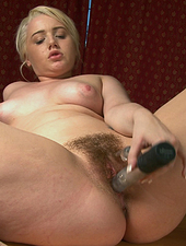 Jenny Davies reveals her hairy pussy at the office