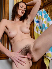 Super Hairy Brunette Spreads Her Furry Legs And Pussy Wide