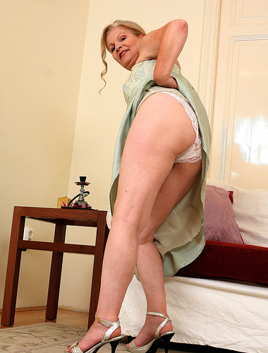 Elegant and sexy 62 year old Nelli from AllOver30 strutting her stuff