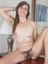 Suzette was in her bedroom putting on some make up when she decided to strip out of her pink skirt, top and underwear. She pulls on her underarm hair and then plays with her hairy pussy!