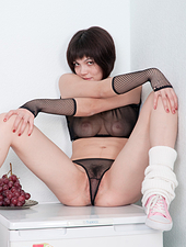 Look under Sasha M's short skirt and you will see hair poking though her mesh panties. She strips down and spreads her juicy pink bush with her long soft fingers.
