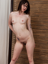 Hairy girl Thelma Sleaze is a sexy brunette beauty wearing glasses as she works out at home using an exercise ball and then she gets naked and gives her very hairy pussy an intense workout.
