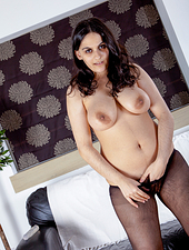 Riani is a woman that is determined to seduce her lover. This hairy girl goes to her lover's office and begins to strip off her mini dress and stockings. She plays with her dildo once she's naked.