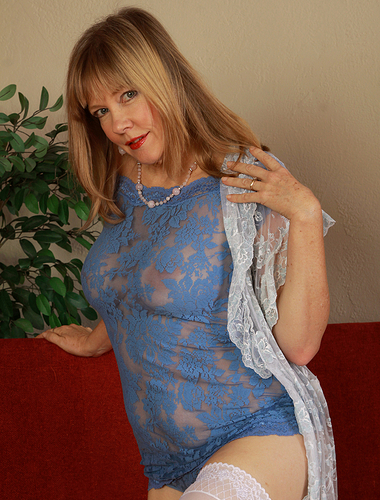 Beautiful and blonde 52 year old Lilly slips off her hot blue lingerie
