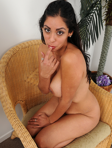 Elegant and exotic Bianca Mendoza pulling at her shaven beaver