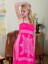 Kira S is a sexy blonde wearing a sexy pink dress with black pantyhose holding a red rose in the living room as she slowly strips naked and uses her black silky pantyhose to tease her hairy pussy.