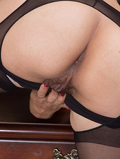 Lucy Dutch is a hot American all-natural girl with sexy glasses and in her office. She slowly takes off her stockings and clothes and reveals her very hairy pussy. With her 32C breasts she is very hot.