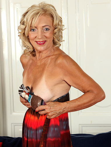 65 years old housewife Kamilla putting on a rather sexy strip show here