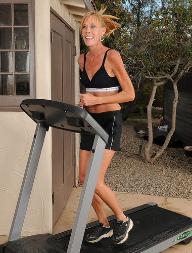 Skinny 36 yr old Stacey Y takes a pause from her workout and strips