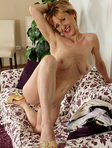 49 year old blonde Tina M from AllOver30 slips off her denim skirt