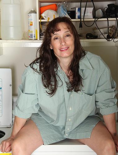 41 year old brunette Celeste Carpenter tugging at her pussy lips here