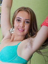 Alya Shon stands beautiful but is better naked. The orange dress comes off and her green lingerie does too. Once naked, she shows off her hairy pits, and her very hairy pussy, done in an awesome way.