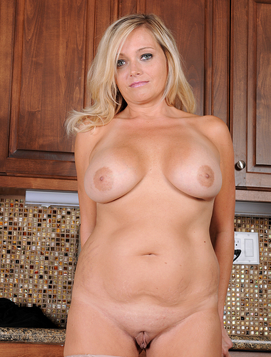 39 year old Lexxi Lash showing off her massive melons in the kitchen