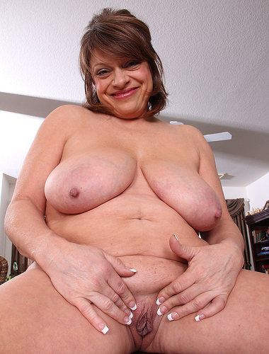 Big and busty Penny Beavers from AllOver30 squeezing her big tits