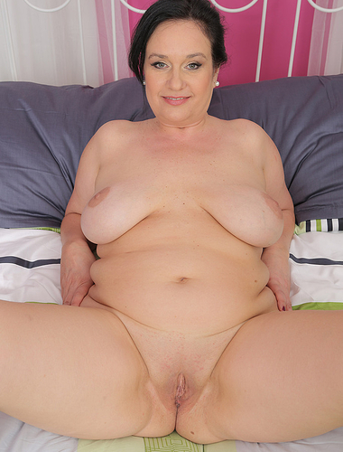 Horny 48 year old Ria Black strips and fingers her mature pussy