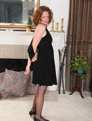 Cute redheaded Roxanne Clemmens gets naked in the living room