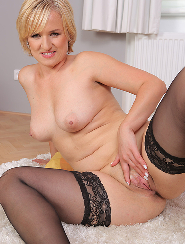Blonde 30 year old Lu Berry fingering her mature shaven pussy here