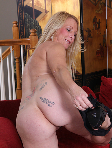 Blonde sexpot Jackie takes off her dress and heels to fuck herself with a toy