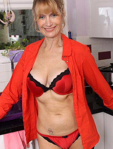 Mature babe Jane B rocking in red