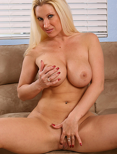 Busty Milf Devon Strips And Plays With Her Titties