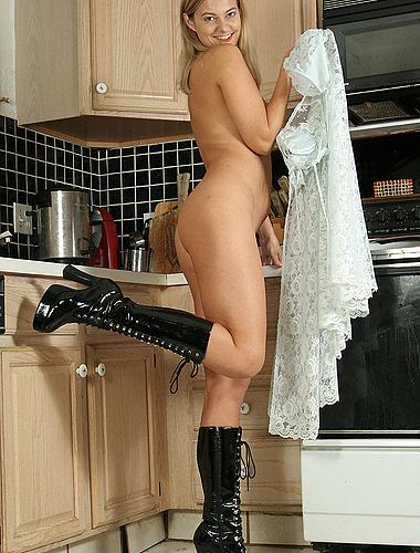 Blonde Milf Spreads Her Long Legs Wide In The Kitchen
