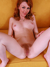 Hairy redheaded dame shows her muff